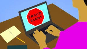 illustration of person on computer which has fraud alert visible on screen